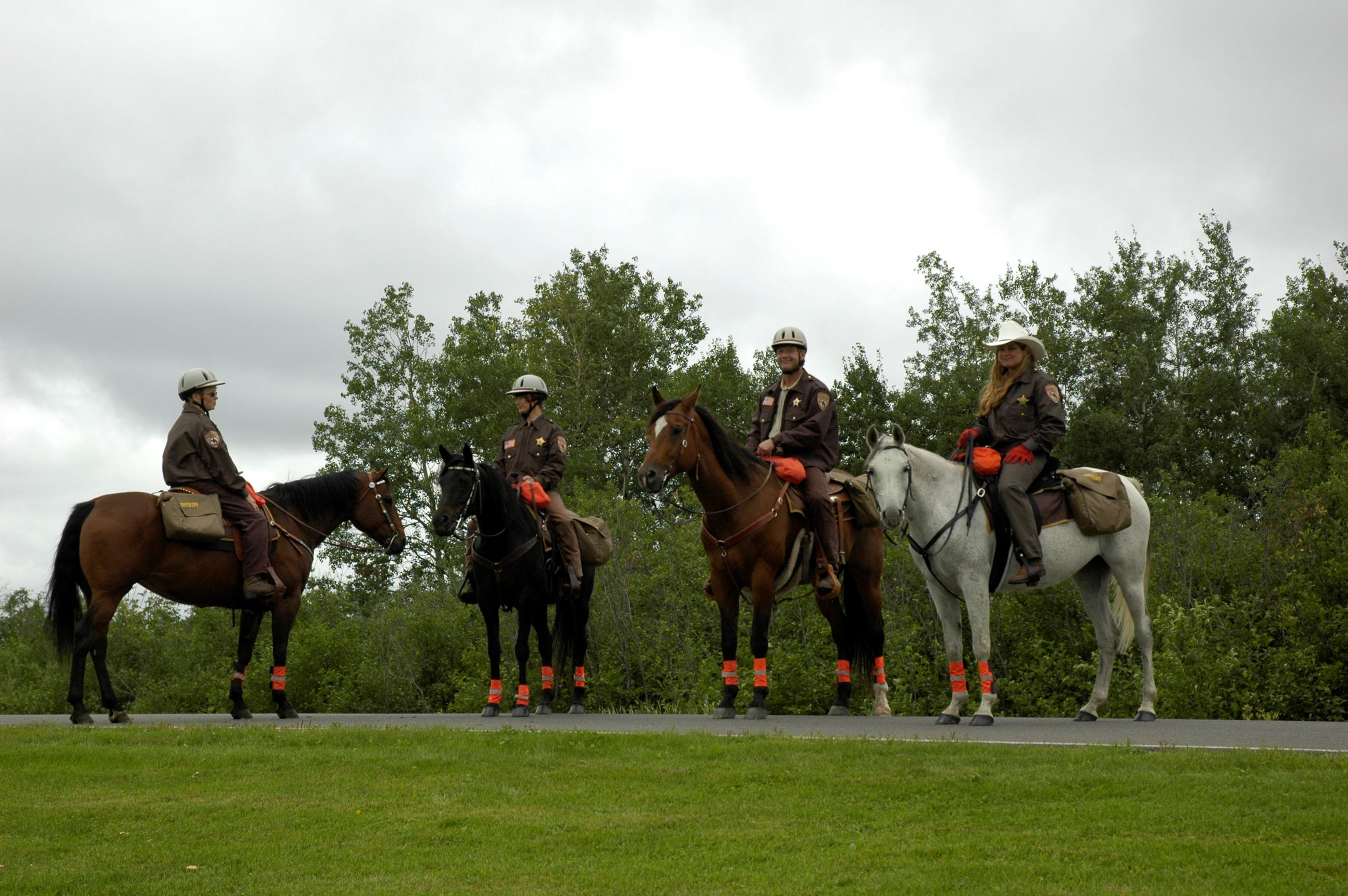 Four mounted officers with emergency packs