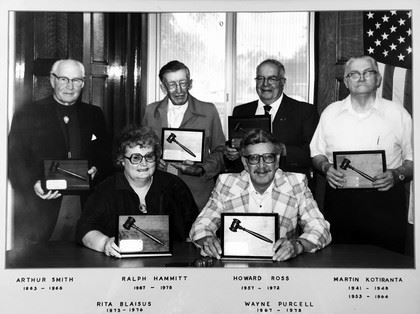Black and white image of five commissions in 1970s